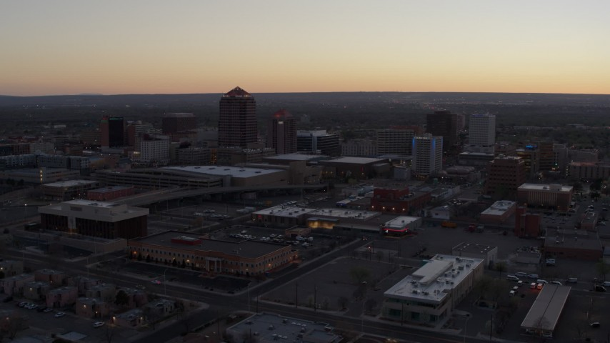5.7K stock footage aerial video reverse view of office tower and hotel tower at sunset near office high-rises, Downtown Albuquerque, New Mexico Aerial Stock Footage | DX0002_123_006