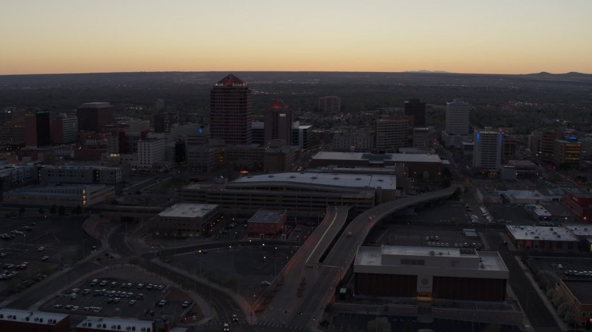 5.7K stock footage aerial video approach and pass Albuquerque Plaza and Hyatt Regency at sunset near office high-rises, Downtown Albuquerque, New Mexico Aerial Stock Footage | DX0002_123_007