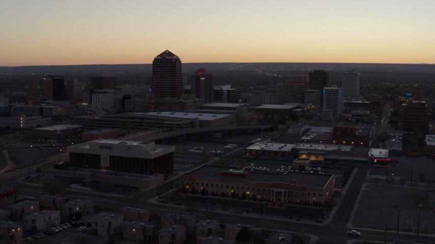 5.7K stock footage aerial video passing Albuquerque Plaza and Hyatt Regency at sunset near office high-rises, Downtown Albuquerque, New Mexico Aerial Stock Footage | DX0002_123_009