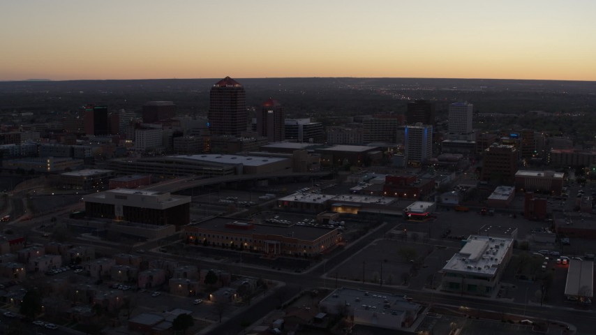 5.7K stock footage aerial video ascend and fly away from Albuquerque Plaza and Hyatt Regency at sunset, Downtown Albuquerque, New Mexico Aerial Stock Footage | DX0002_123_010
