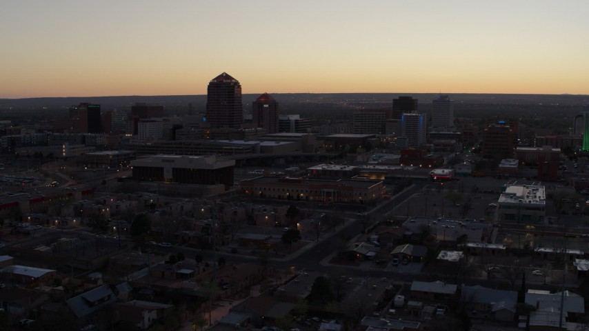 5.7K stock footage aerial video approach Albuquerque Plaza and Hyatt Regency at sunset, Downtown Albuquerque, New Mexico Aerial Stock Footage | DX0002_123_011