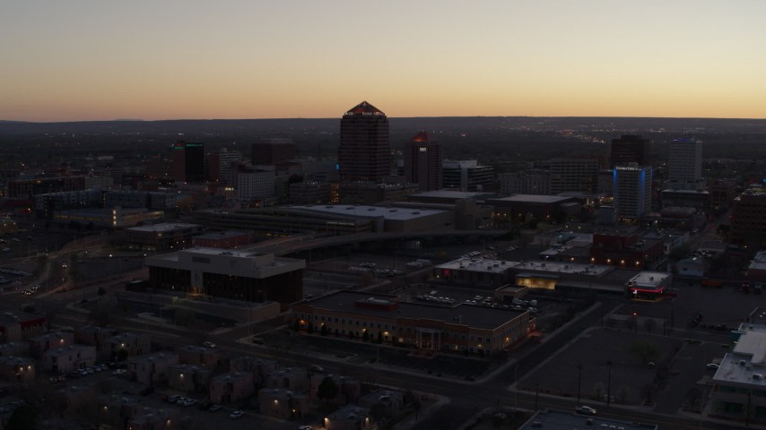 5.7K stock footage aerial video passing Albuquerque Plaza and Hyatt Regency at sunset, Downtown Albuquerque, New Mexico Aerial Stock Footage | DX0002_123_015