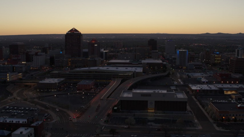 5.7K stock footage aerial video flying by Albuquerque Plaza, Hyatt Regency and city high-rises at sunset, Downtown Albuquerque, New Mexico Aerial Stock Footage | DX0002_123_016