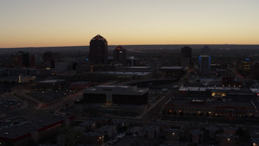 5.7K stock footage aerial video of a wide orbit of Albuquerque Plaza, Hyatt Regency and city high-rises at sunset, Downtown Albuquerque, New Mexico Aerial Stock Footage | DX0002_123_017