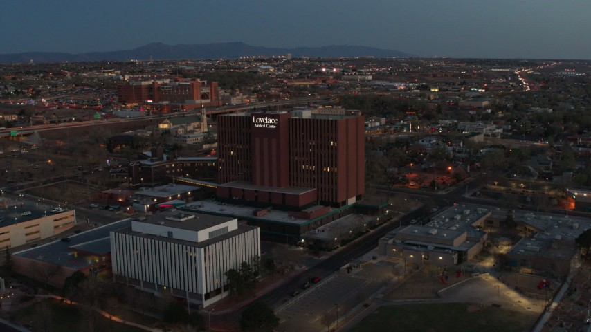 5.7K stock footage aerial video of a reverse view of a hospital at twilight in Albuquerque, New Mexico Aerial Stock Footage | DX0002_123_018