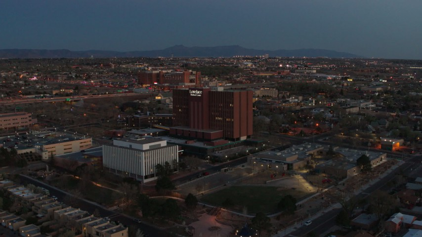 5.7K stock footage aerial video fly toward and orbit a hospital at twilight in Albuquerque, New Mexico Aerial Stock Footage | DX0002_123_019