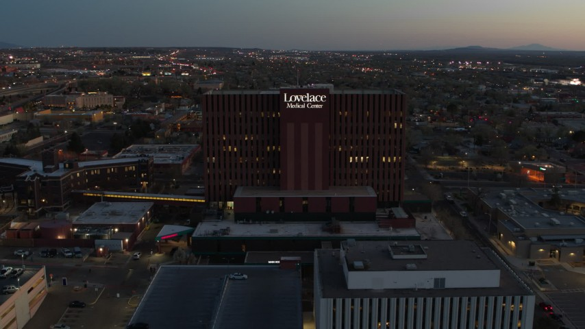 5.7K stock footage aerial video of circling a hospital at twilight in Albuquerque, New Mexico Aerial Stock Footage | DX0002_123_020