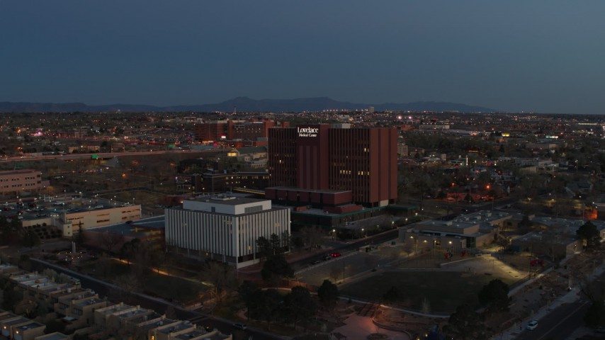 5.7K stock footage aerial video of a reverse view of a hospital complex at twilight in Albuquerque, New Mexico Aerial Stock Footage | DX0002_123_021