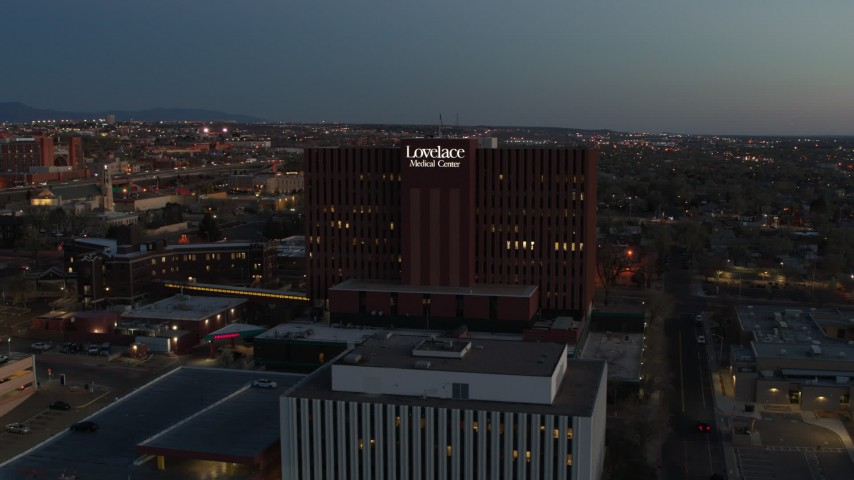 5.7K stock footage aerial video approach a hospital building at twilight in Albuquerque, New Mexico Aerial Stock Footage | DX0002_123_022