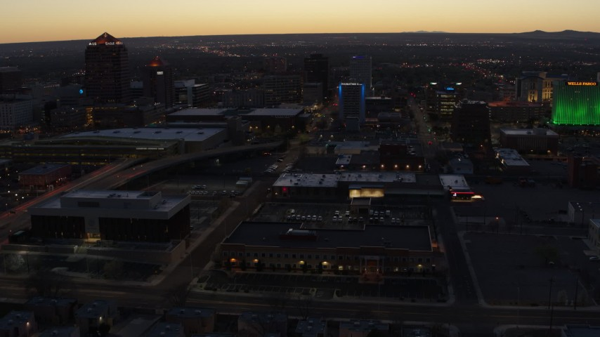 5.7K stock footage aerial video approach a hotel and office buildings at twilight, Downtown Albuquerque, New Mexico Aerial Stock Footage | DX0002_123_023