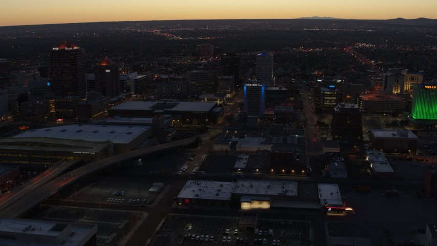 5.7K stock footage aerial video flying away from hotel and office buildings at twilight, Downtown Albuquerque, New Mexico Aerial Stock Footage | DX0002_123_024