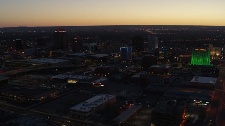 5.7K stock footage aerial video of hotel and office buildings at twilight, Downtown Albuquerque, New Mexico Aerial Stock Footage | DX0002_123_026