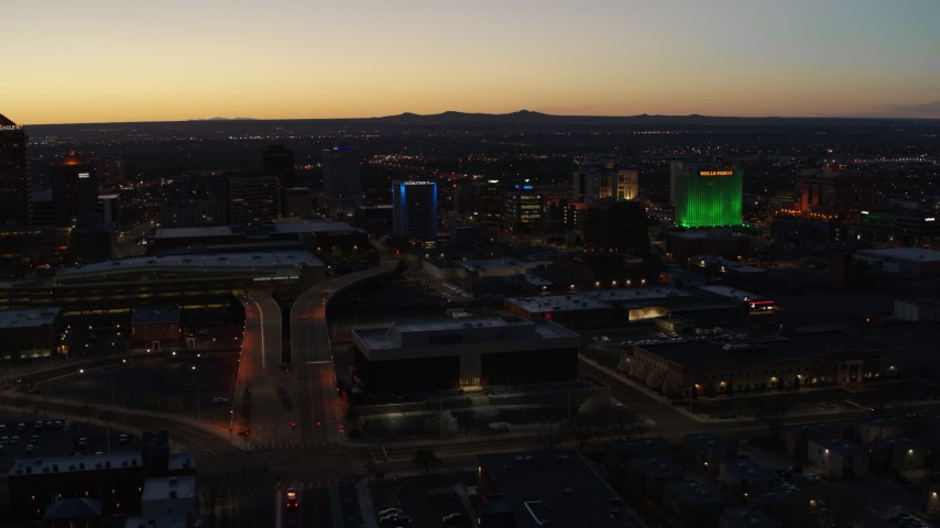 5.7K stock footage aerial video of the DoubleTree hotel with blue lighting near office buildings at twilight, Downtown Albuquerque, New Mexico Aerial Stock Footage | DX0002_123_029