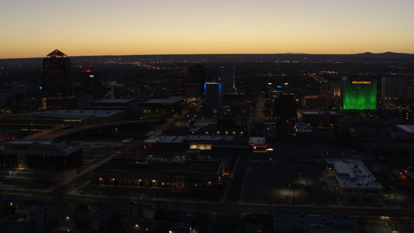 5.7K stock footage aerial video of passing DoubleTree hotel with blue lighting near office buildings at twilight, Downtown Albuquerque, New Mexico Aerial Stock Footage | DX0002_123_030