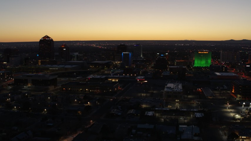 5.7K stock footage aerial video flyby and approach DoubleTree hotel with blue lighting near office buildings at twilight, Downtown Albuquerque, New Mexico Aerial Stock Footage | DX0002_123_031
