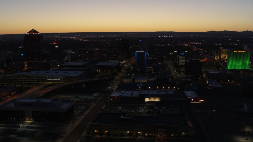 5.7K stock footage aerial video fly past hotel with blue lighting near office towers at twilight, Downtown Albuquerque, New Mexico Aerial Stock Footage | DX0002_123_033