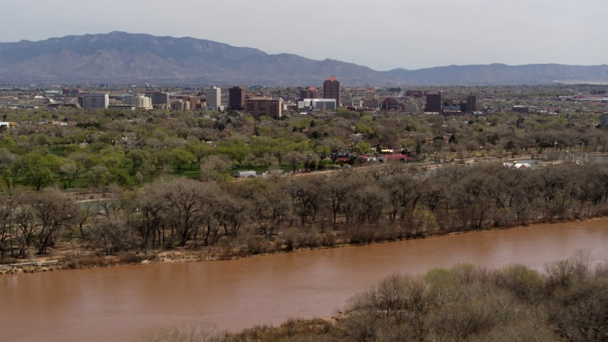 5.7K stock footage aerial video of high-rise office buildings seen from the Rio Grande, Downtown Albuquerque, New Mexico Aerial Stock Footage | DX0002_124_001