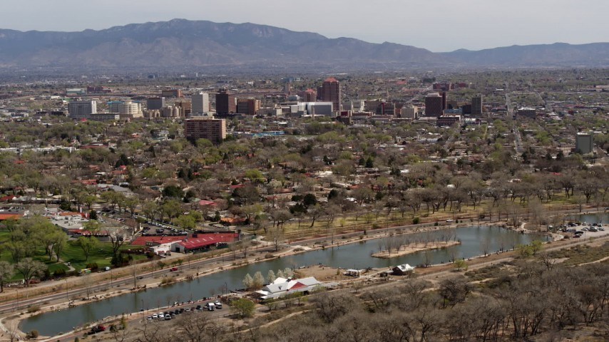 5.7K stock footage aerial video wide view of high-rise office buildings seen from Tingley Beach, Downtown Albuquerque, New Mexico Aerial Stock Footage | DX0002_124_003