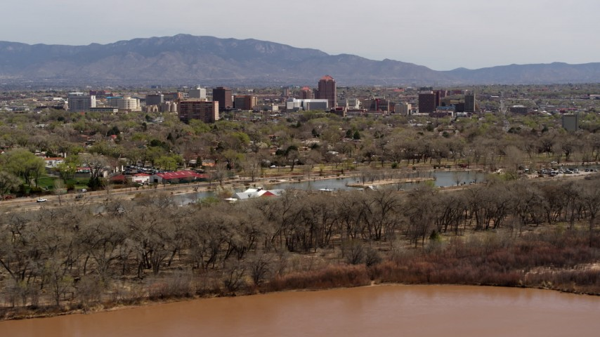 5.7K stock footage aerial video wide view of high-rise office buildings, descend beside park, Rio Grande, Downtown Albuquerque, New Mexico Aerial Stock Footage | DX0002_124_004
