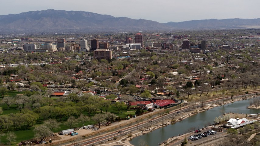 5.7K stock footage aerial video flying by high-rise office buildings seen from Tingley Beach, Downtown Albuquerque, New Mexico Aerial Stock Footage | DX0002_124_006