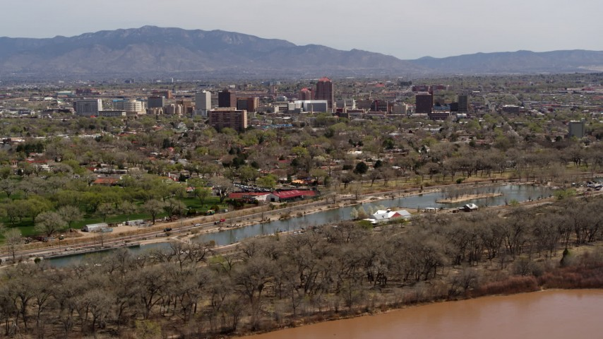 5.7K stock footage aerial video of high-rise office buildings seen from city park, Downtown Albuquerque, New Mexico Aerial Stock Footage | DX0002_124_009