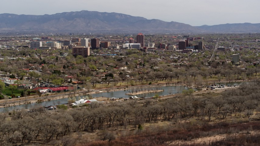 5.7K stock footage aerial video of high-rise office buildings seen from Tingley Beach, Downtown Albuquerque, New Mexico Aerial Stock Footage | DX0002_124_010