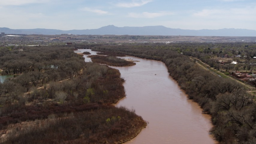 5.7K stock footage aerial video of flying over the Rio Grande, approach small islands in the river in Albuquerque, New Mexico Aerial Stock Footage | DX0002_124_012