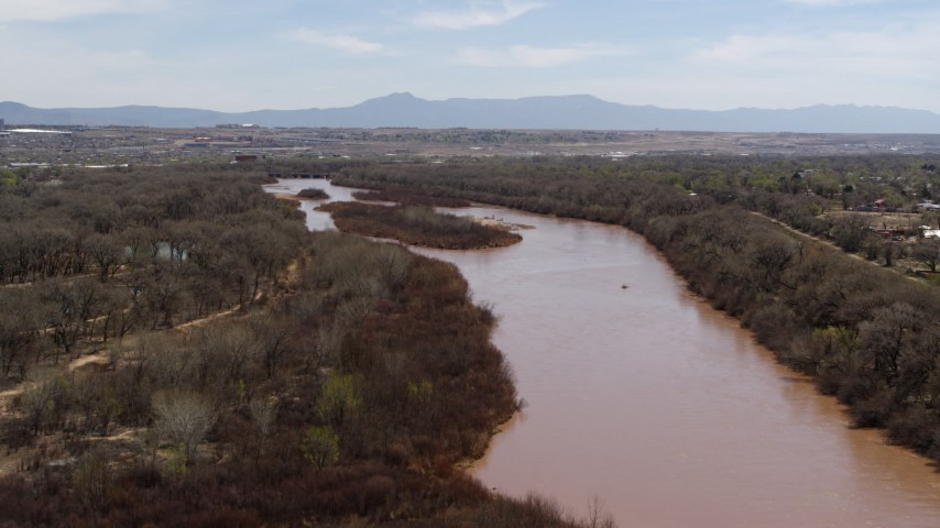 5.7K stock footage aerial video of flying away from islands in the Rio Grande river in Albuquerque, New Mexico Aerial Stock Footage | DX0002_124_013