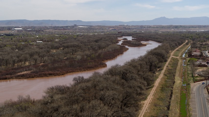 5.7K stock footage aerial video of flying by the Rio Grande river in Albuquerque, New Mexico Aerial Stock Footage | DX0002_124_015
