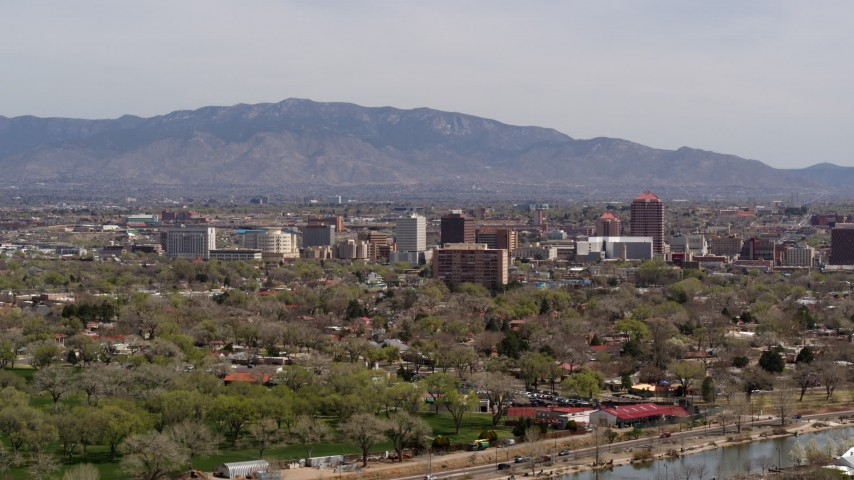 5.7K stock footage aerial video of a wide view of high-rise office buildings, distant mountains, Downtown Albuquerque, New Mexico Aerial Stock Footage | DX0002_124_017
