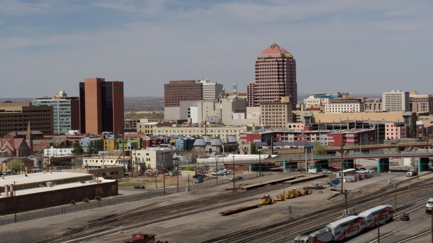 5.7K stock footage aerial video of an office high-rise seen from train tracks, Downtown Albuquerque, New Mexico Aerial Stock Footage | DX0002_124_020