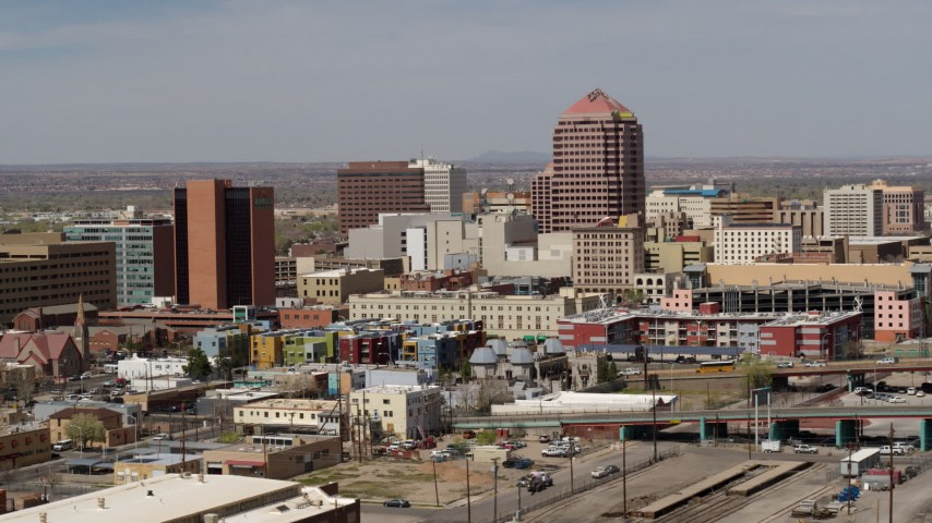 5.7K stock footage aerial video of an office high-rise towering over city buildings, Downtown Albuquerque, New Mexico Aerial Stock Footage | DX0002_124_022