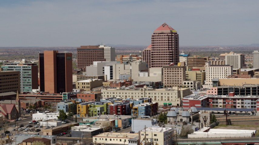 5.7K stock footage aerial video of Albuquerque Plaza office high-rise and neighboring buildings, Downtown Albuquerque, New Mexico Aerial Stock Footage | DX0002_124_024