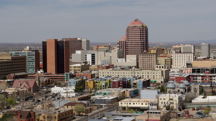 5.7K stock footage aerial video of Albuquerque Plaza office high-rise and surrounding buildings, Downtown Albuquerque, New Mexico Aerial Stock Footage | DX0002_124_025
