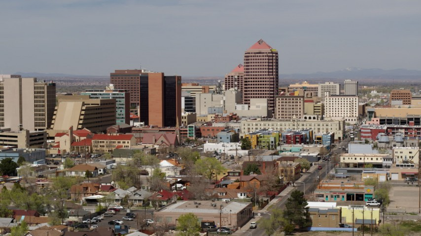 5.7K stock footage aerial video fly away from and by Albuquerque Plaza office high-rise and surrounding buildings, Downtown Albuquerque, New Mexico Aerial Stock Footage | DX0002_124_027
