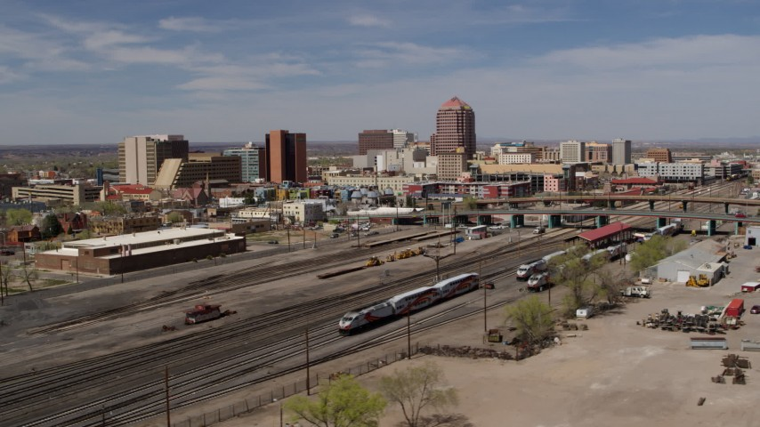 5.7K stock footage aerial video flyby railroad tracks with view of Albuquerque Plaza office high-rise, Downtown Albuquerque, New Mexico Aerial Stock Footage | DX0002_124_028
