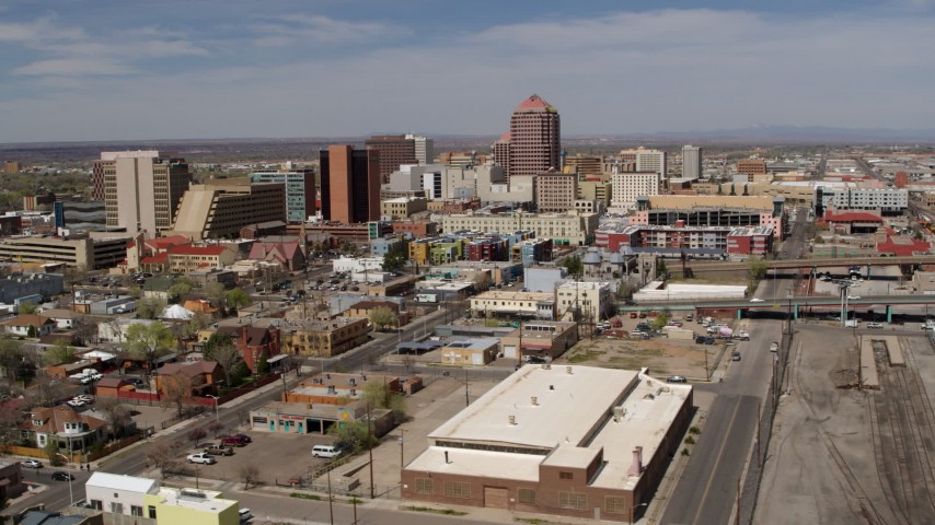 5.7K stock footage aerial video flyby train tracks, focus on Albuquerque Plaza and surrounding buildings, Downtown Albuquerque, New Mexico Aerial Stock Footage | DX0002_124_030