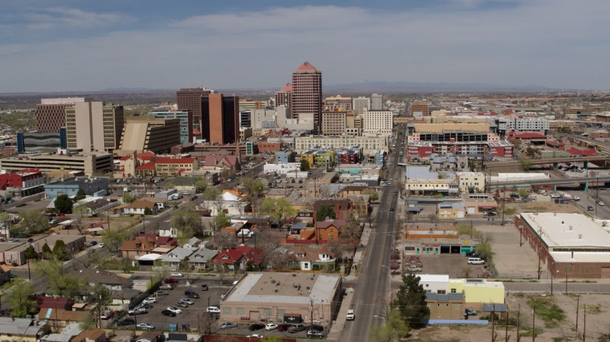 5.7K stock footage aerial video flyby and away from Albuquerque Plaza and surrounding buildings, Downtown Albuquerque, New Mexico Aerial Stock Footage | DX0002_124_031
