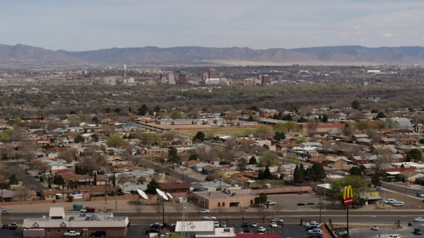 5.7K stock footage aerial video of Downtown Albuquerque, seen from suburban homes, New Mexico Aerial Stock Footage | DX0002_126_011