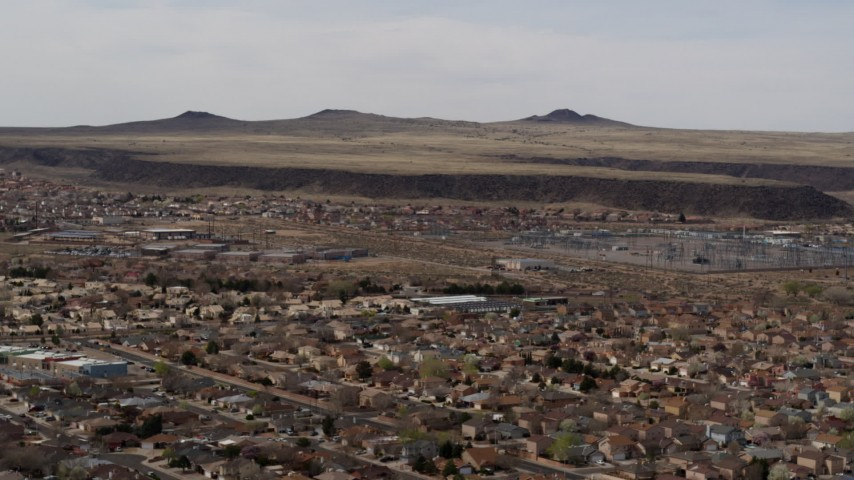 5.7K stock footage aerial video of passing by a suburban neighborhood, Albuquerque, New Mexico Aerial Stock Footage | DX0002_126_017