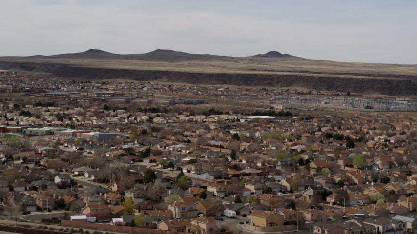 5.7K stock footage aerial video of descend past suburban neighborhood, reveal freeway, Albuquerque, New Mexico Aerial Stock Footage | DX0002_126_018
