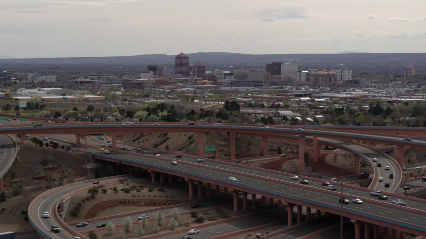 5.7K stock footage aerial video of Downtown Albuquerque seen from a freeway interchange, New Mexico Aerial Stock Footage | DX0002_126_020