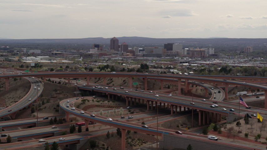 5.7K stock footage aerial video of Downtown Albuquerque seen while passing by freeway interchange, New Mexico Aerial Stock Footage DX0002_126_022 | Axiom Images
