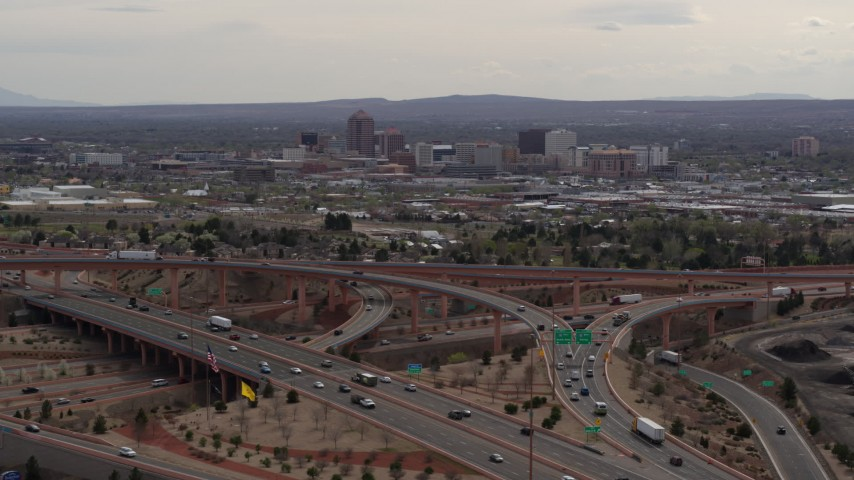 5.7K stock footage aerial video of Downtown Albuquerque seen from freeway interchange traffic, New Mexico Aerial Stock Footage | DX0002_126_025