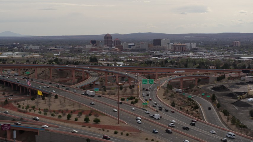 5.7K stock footage aerial video of Downtown Albuquerque buildings seen from freeway interchange traffic, New Mexico Aerial Stock Footage | DX0002_126_027