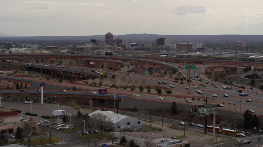 5.7K stock footage aerial video of Downtown Albuquerque buildings seen from a freeway interchange, New Mexico Aerial Stock Footage | DX0002_126_032