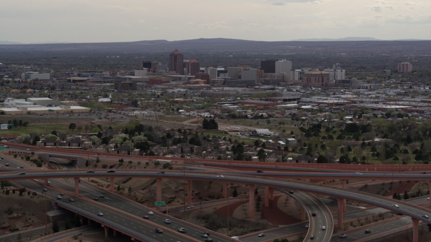 5.7K stock footage aerial video of Downtown Albuquerque high-rises seen from freeway interchange, New Mexico Aerial Stock Footage | DX0002_126_034
