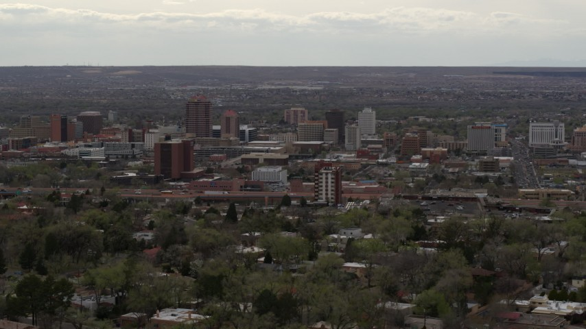 5.7K stock footage aerial video of the city's high-rise buildings seen from neighborhood, Downtown Albuquerque, New Mexico Aerial Stock Footage   DX0002_126_036
