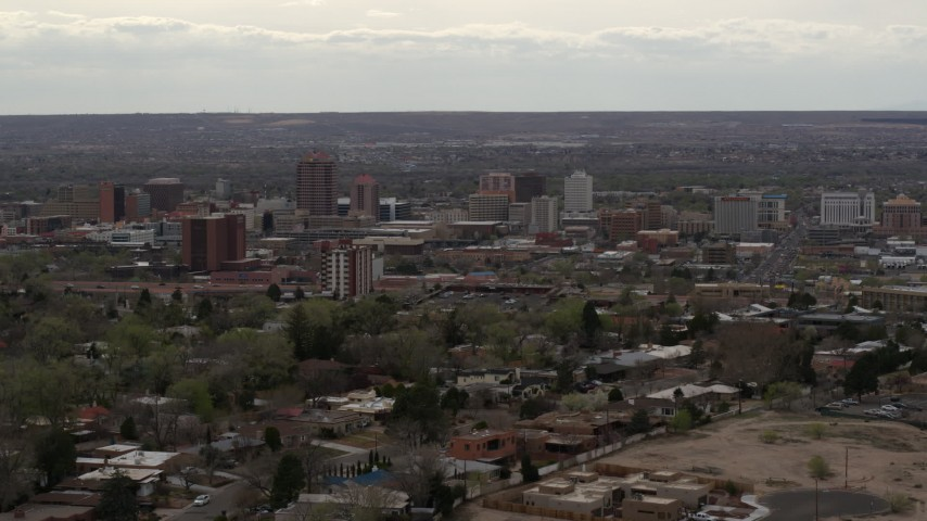 5.7K stock footage aerial video reverse view of city's high-rise buildings seen from neighborhood, Downtown Albuquerque, New Mexico Aerial Stock Footage | DX0002_126_037