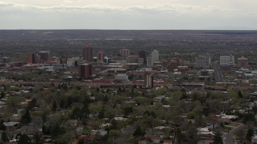 5.7K stock footage aerial video of the city's high-rise buildings seen from neighborhood, Downtown Albuquerque, New Mexico Aerial Stock Footage | DX0002_126_038